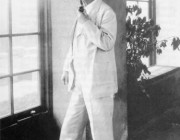 Mark Twain full length at window