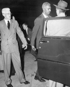 (Original Caption) New York: Held In Contempt Of Court. Mystery writer Dashiel Hammett (Left), chairman of the Civil Rights Congress' Bail Fund, and W. Alphaeus Hunton, a trustee, are handcuffed together as they enter a police van after being remanded to cells for contempt of court, July 9. Both men refused to answer Federal Judge Sylvester Ryan's questions about who put up the money for the four Communist leaders who have jumped their bail. Another trustee, millionaire Frederick Vanderbilt Field, has been sentenced to 90 days on the same charge.